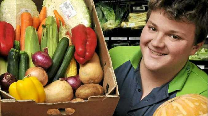 Wyalla Fruit Mart manager Ben Donnelly displays some of the produce in cheap and plentiful supply.