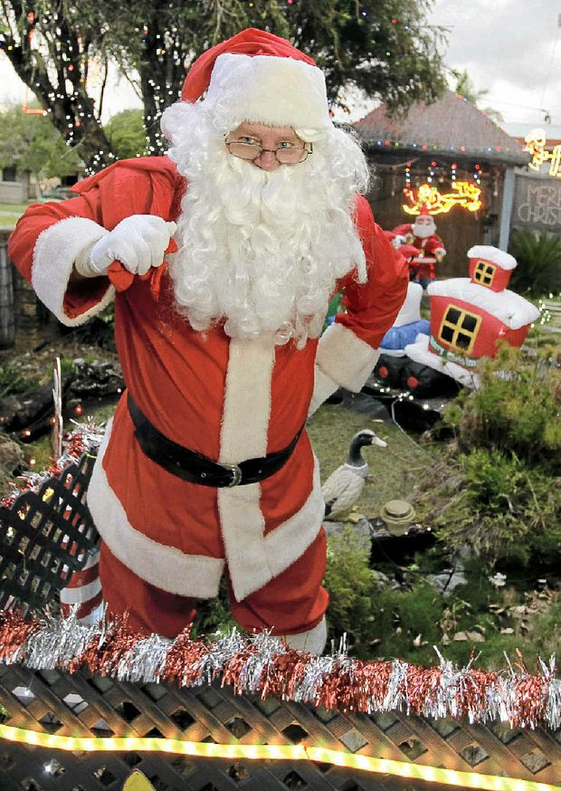 Terry Haden, who has played Santa for the past 15 years, is saddened that young thieves have stolen from his wishing well..