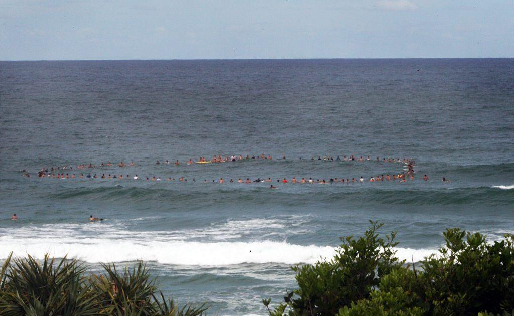 Paddle-out for drowned Kenyan teenager Samuel Mwangi Macharia at Cabarita Headland.