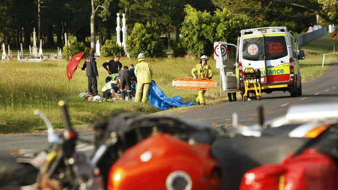 Paramedics tend to a 33-year-old motorcyclist after he collided with a car at Hattonvale.