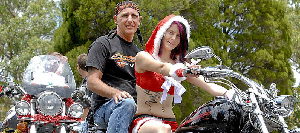 Charlie Pantalleresco and Vanessa Bennett rev up Mr Pantalleresco's Harley Davidson Soft Tail.