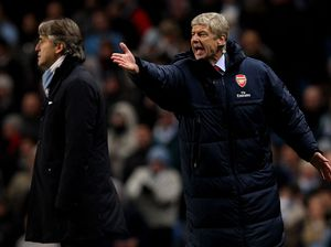 Arsenal out of title race: Wenger