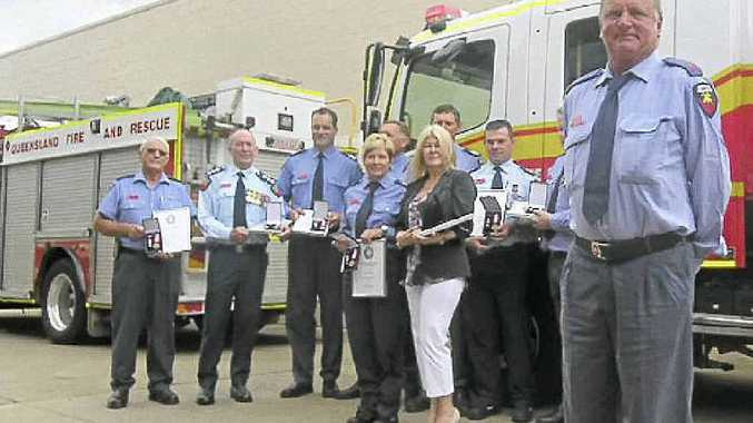 Gin Gin auxiliary firefighter David Sinden and the eight other recipients of medals at a special service on Friday.