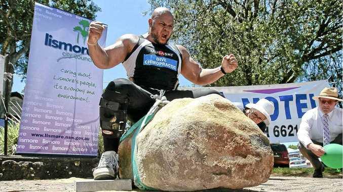 Strongman Derek Boyer lifting a 760kg rock to take the title of Australia's Strongest Man on Australia Day in Lismore last January.