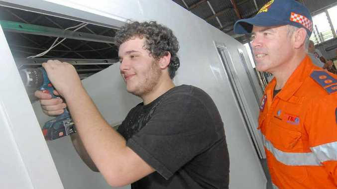 David Grech adds the last door hinge with SES controller Justin Englert.