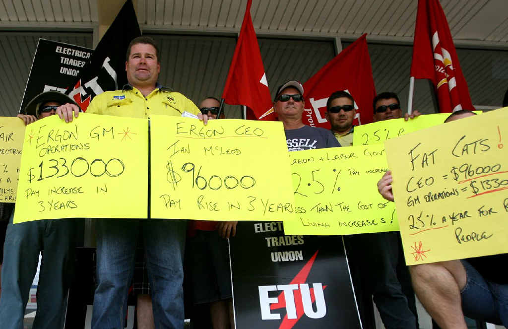 Craig Giddens, of the ETU, leads a group of protesters outside Robert Schwarten's office.