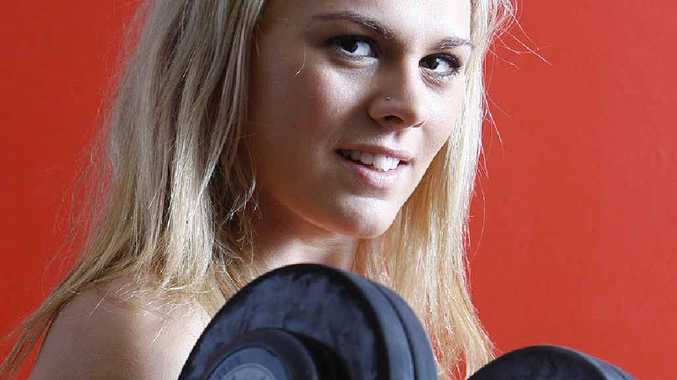 Kayla Plume, 21, has been lifting weights for seven years, building a strong and healthy body.