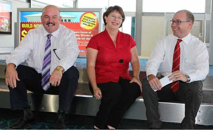 Whitsunday Mayor Mike Brunker, Tourism Minister Jan Jarratt and Acting Premier Andrew Fraser celebrate the launch of the revamped Whitsunday Coast Airport.