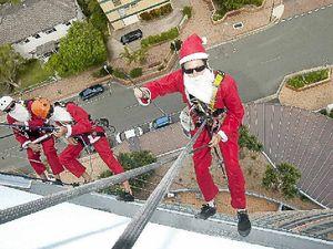 Abseiling part of Santa's job
