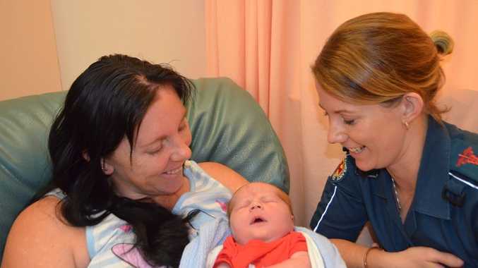 Proud Mum Sam Harbecke with her new baby Wolfgang and paramedic Nicole Thies.