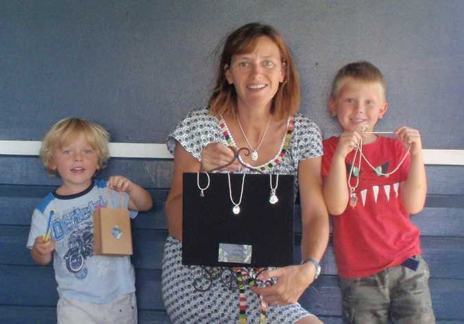 Dorothy Ticknor with two of her boys, Max (left) and Charlie (right) with some of her necklaces. Photo Contributed