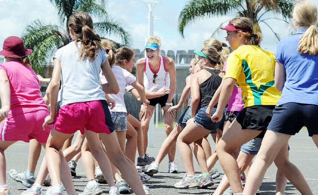 Australian and Queensland netball representative Laura Geitz puts juniors through their paces in Hervey Bay.