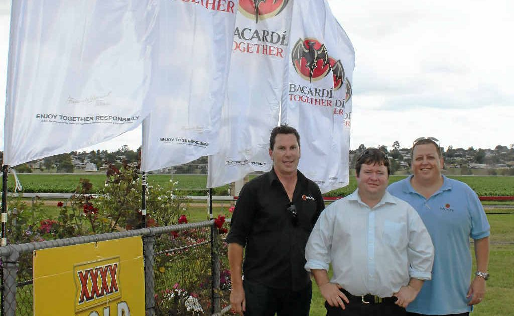 (From left) Bacardi manager Adam Keleher, Warwick Turf Club committee member Nick Inmon and Bacardi sales manager Shane Gierke set up for the Boxing Day Races.