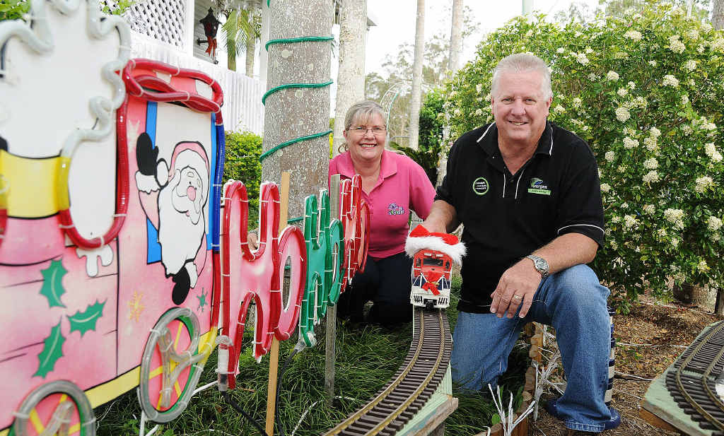 Suzanne and David Jamieson celebrate winning this year's Christmas lights competition.