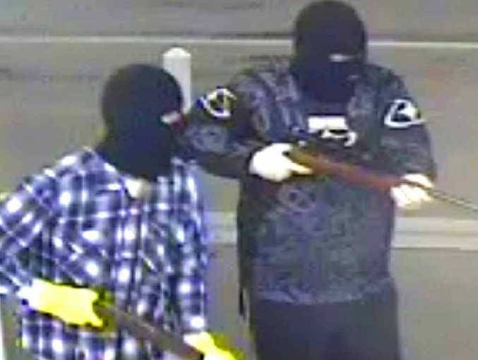 CCTV video footage shows two men, armed with rifles, during an armed robbery at the Oaks Service Station on the Rockhampton Yeppoon Rd in October.