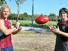 Brisbane Lions young gun Daniel Rich handballs to vision-impaired physiotherapist Kane Stockhill.