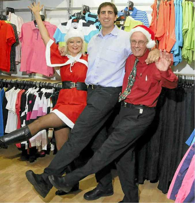 Hannas Department Store employees (from left) Catherine Byrne, Paul Hanna and Robert Davy celebrate a strong Christmas trading period.