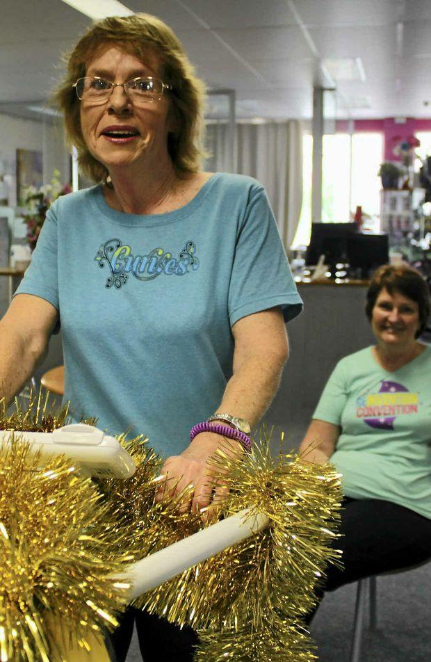 Cheryl Bohan, with Curves co-owner Sue Ferguson (sitting) is looking forward to a healthy Christmas, having lost 45kg.