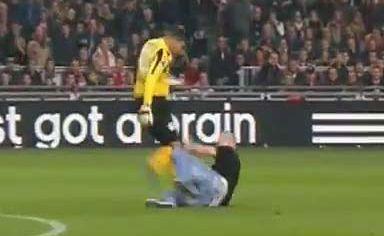 AZ Alkmaar goalkeeper Esteban Alvarado lashes out at an Ajax fan.