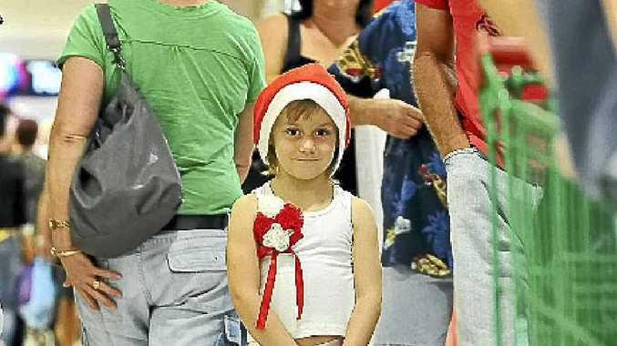 Alyssa Flintoff was full of Christmas spirit as she helped her mum do some Christmas shopping at Hinkler Central.