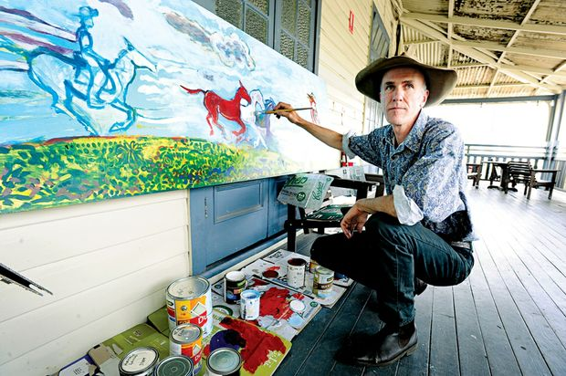 Artist Jimmy Willing has begun the process of transforming the art work on front of the Nimbin Hotel.