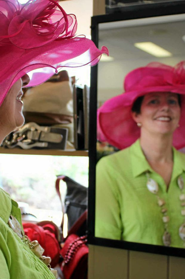 Lyn McKillop shows how to work a hot pink hat with lime green.
