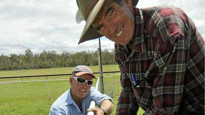 Leo (left) and Jim Neill-Ballantine prepare the winners' enclosure at Calliope.