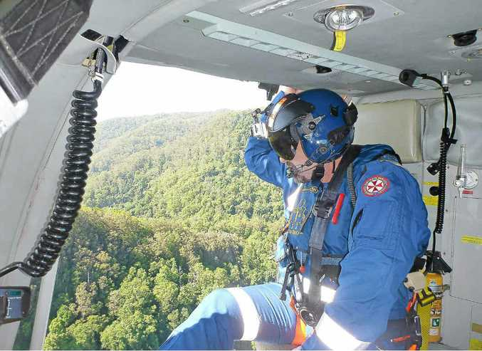 NSW Ambulance paramedic Steve Goulding in the Westpac Life Saver Rescue Helicopter searching for missing man Christopher Keyes in rugged bushland near Mullumbimby.