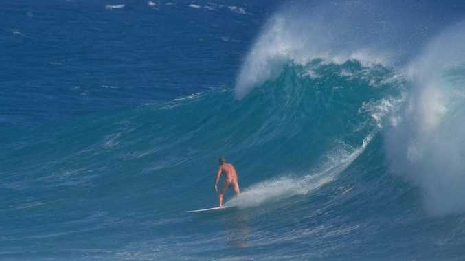 The unidentified nude surfer at Snapper Rocks.