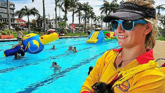 Lifeguard Jessica Clarey keeps a watch on bathers at Anzac Pool.
