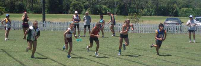 Action from the start of a sprint event at a previous Brunswick Heads athletics carnival.