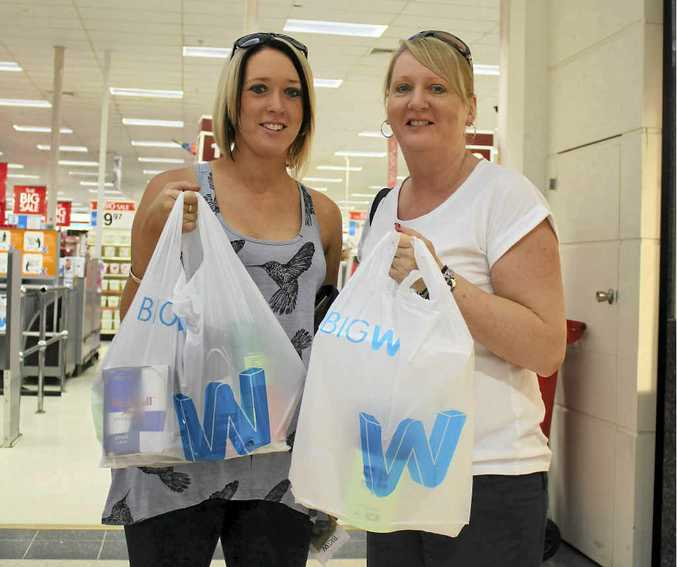 Rhiannon Lawson and Leanne Berry depart Big W with a swag of goodies during yesterday's sale.