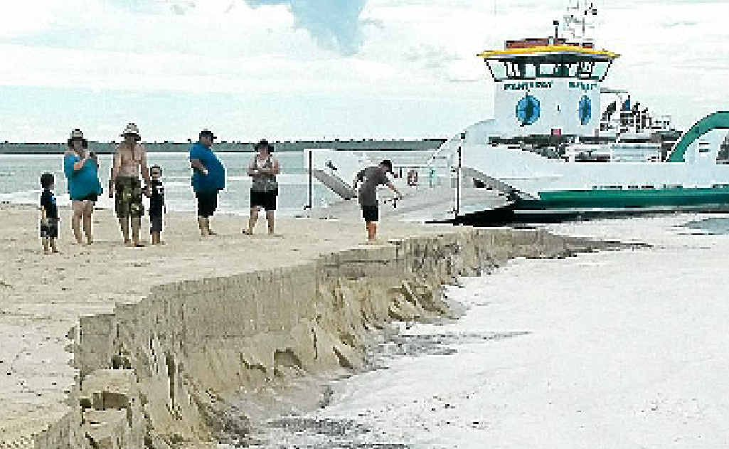 The barge landing area at Inskip Point on Tuesday afternoon caved in just minutes after cars were loaded on to waiting barges.
