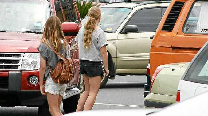 Two young girls on skateboards in Jonson Street traffic last Friday.