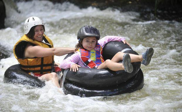 Juana and Mayha Davies of Woombah enjoy some tubing at the Nymboida Canoe Centre Photo: Adam Hourigan/The Daily Examiner