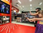 Sophie Reyes and Ana-Lucia Reyes (front) try out their moves with the X-Box Kinect at the Dick Smith store at Caneland Central.