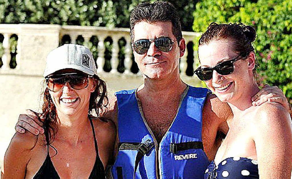 Amie Partleton and Emma Baker flank entertainment guru Simon Cowell in Barbados.