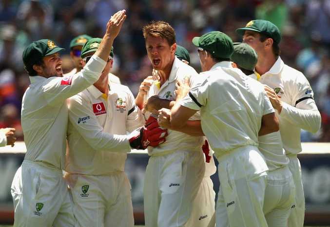 Australia celebrate another wicket.