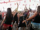 Crowds gather to try their hand at Brazilian Samba Dance workshop at Woodford Folk Festival.