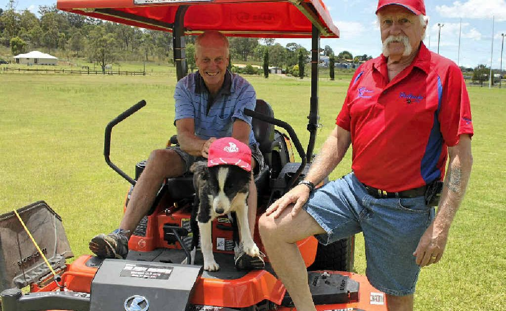 AFL Redbacks football operations manager Colin Pope (right) with volunteer groundsman and remedial therapist Phil Strang at the new Redbacks oval.