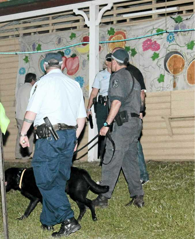 Police with sniffer dog at Tropical Fruits.