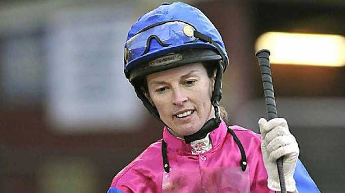 Toowoomba jockey Kristy Banks returns to scale on Tellintaimz after winning at Clifford Park on August 20.