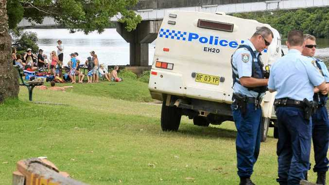 Police at the scene where the body of a man was recovered from the Richmond River at Woodburn.