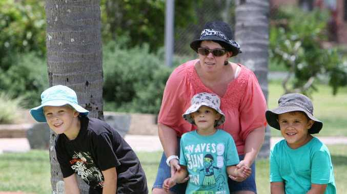 Jodie Gosbee and her children (from left) Caleb Gosbee, Jye Gosbee and Kyan Gosbee enjoy a game of cricket with friends at Mulherin Park yesterday.