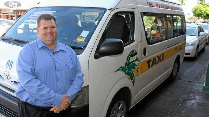 Mackay Taxis general manager Gary Button, at the Wood Street taxi rank yesterday, says the company has a goal to improve its service.