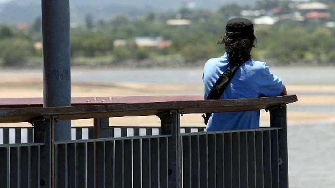 'Jonah', a refugee who jumped off a ship and swam to shore at Hay Point, contemplates his future overlooking the Pioneer River.