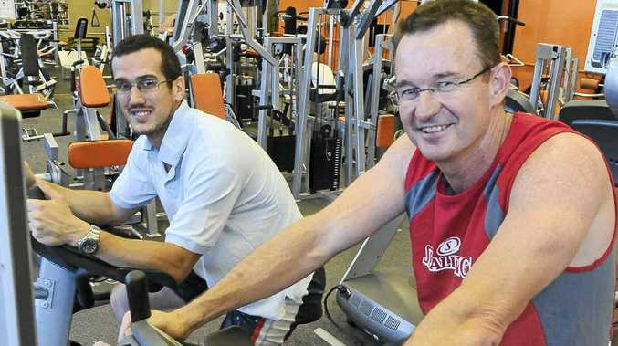 New member Wayne Ingall (right) and established member David Zorzan work out at City Fit.