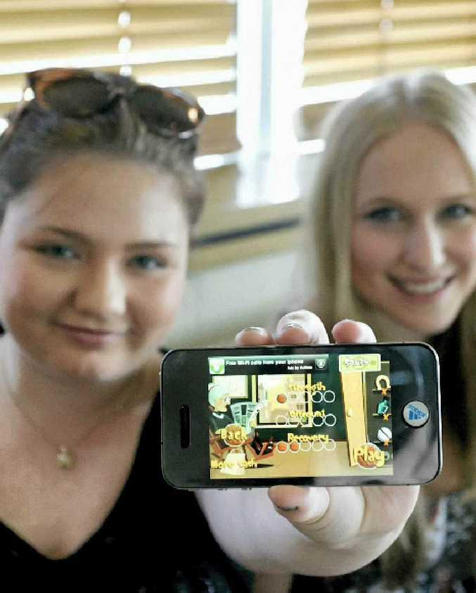 Kasey O'Neill and Taylor Berry with an iPhone4 featuring Angry Gran – one of the popular games available for smart phones.
