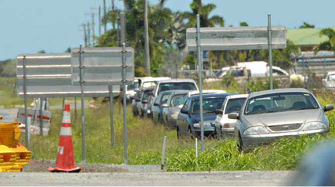 Vehicles parked on the side of busy Boundary Rd, opposite the Mackay airport, yesterday.