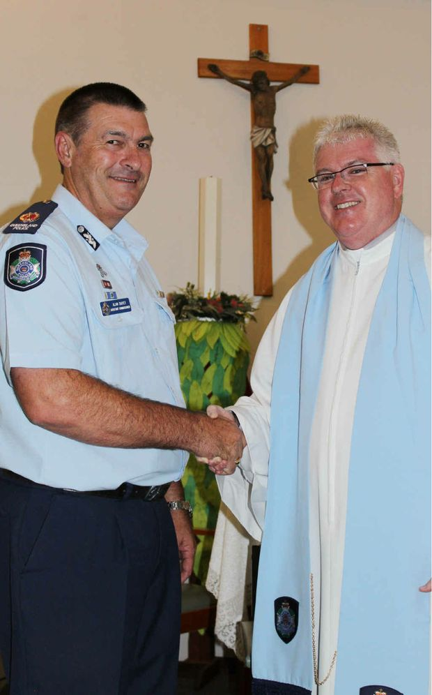 Asst Comm Alan Davey welcomes Central Highlands police chaplain Father Stephen Hanly. Photo: Rebekah Polley